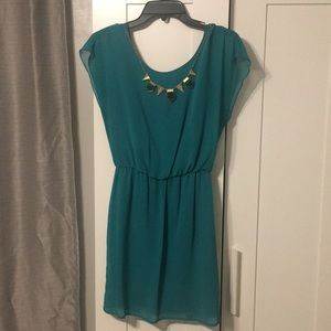 Beautiful teal dress with accented necklace